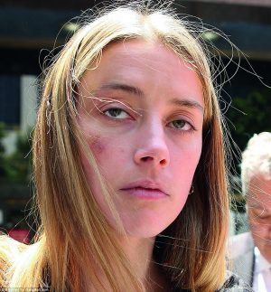34b3cb2100000578-3613134-amber_heard_30_was_granted_a_temporary_restraining_order_against-a-82_1464379672384
